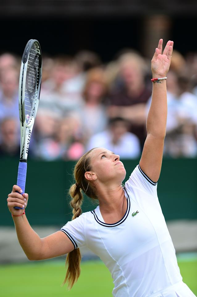 LONDON, ENGLAND - JUNE 27: Dominika Cibulkova of Slovakia serves during the Ladies' Singles second round match against Maria-Teresa Torro-Flor of Spain on day four of the Wimbledon Lawn Tennis Championships at the All England Lawn Tennis and Croquet Club on June 27, 2013 in London, England. (Photo by Mike Hewitt/Getty Images)