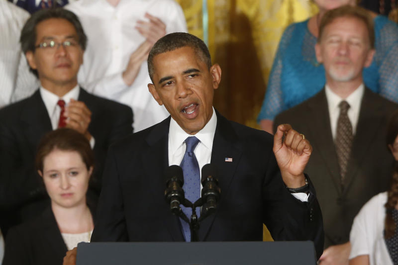 Obama extols health care law amid public doubts