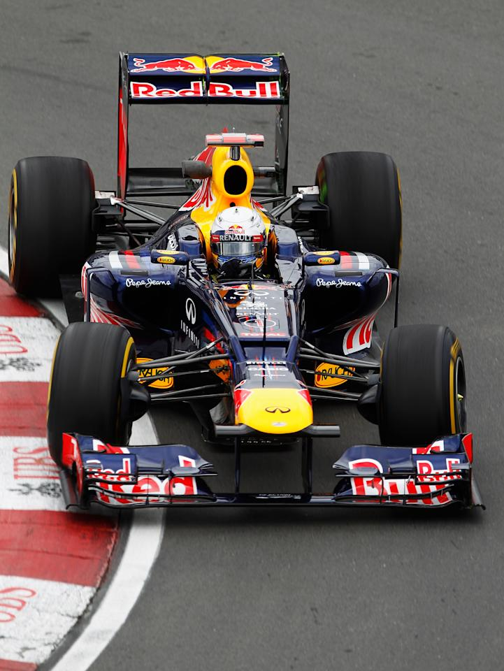 MONTREAL, CANADA - JUNE 08:  Sebastian Vettel of Germany and Red Bull Racing drives during practice for the Canadian Formula One Grand Prix at the Circuit Gilles Villeneuve on June 8, 2012 in Montreal, Canada.  (Photo by Paul Gilham/Getty Images)