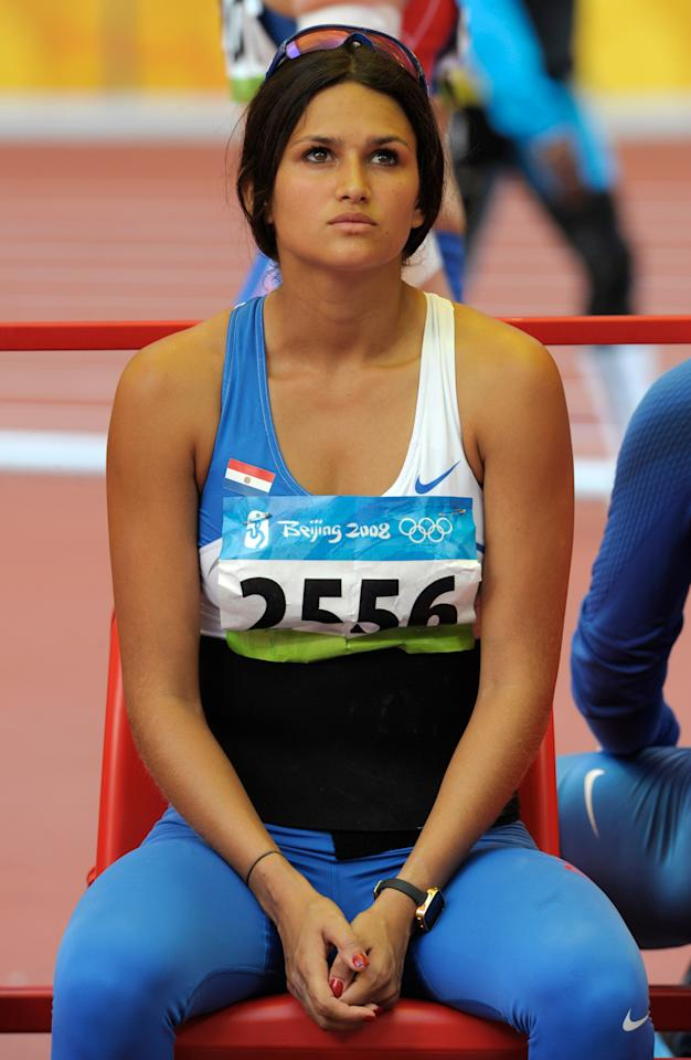 Paraguay's Leryn Franco reacts after an attempt in the qualification for the women's javelin throw during the athletics competitions in the National Stadium  at the Beijing 2008 Olympics in Beijing, Tuesday, Aug. 19, 2008. (AP Photo/Thomas Kienzle)