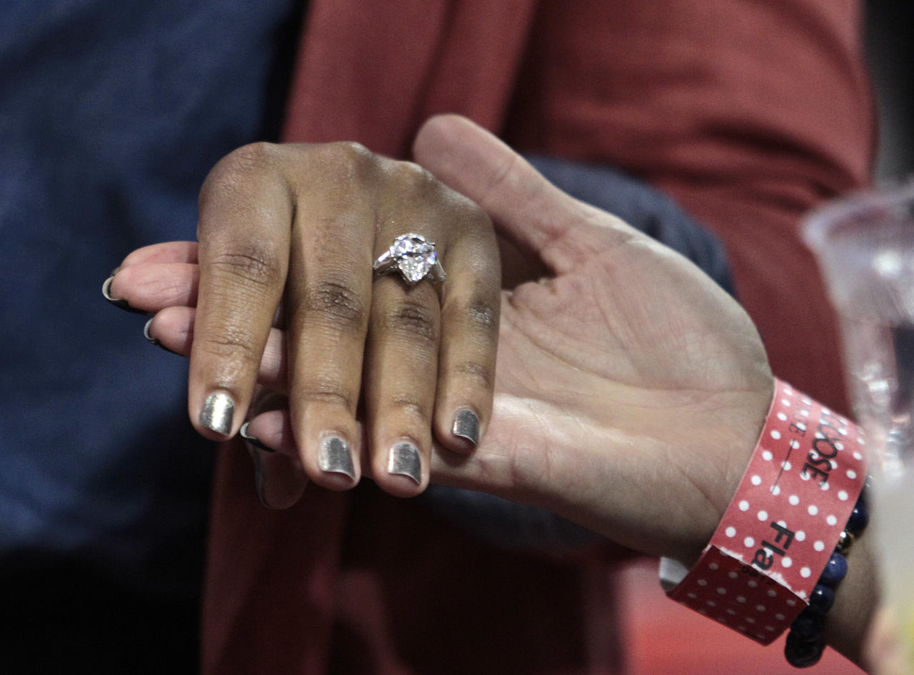 Savannah Brinson shows off her engagement ring from Miami Heat's LeBron James, her fiance, after an NBA basketball game between the Miami Heat and Charlotte Bobcats in Miami, Sunday, Jan. 1, 2012. (AP Photo/Alan Diaz)