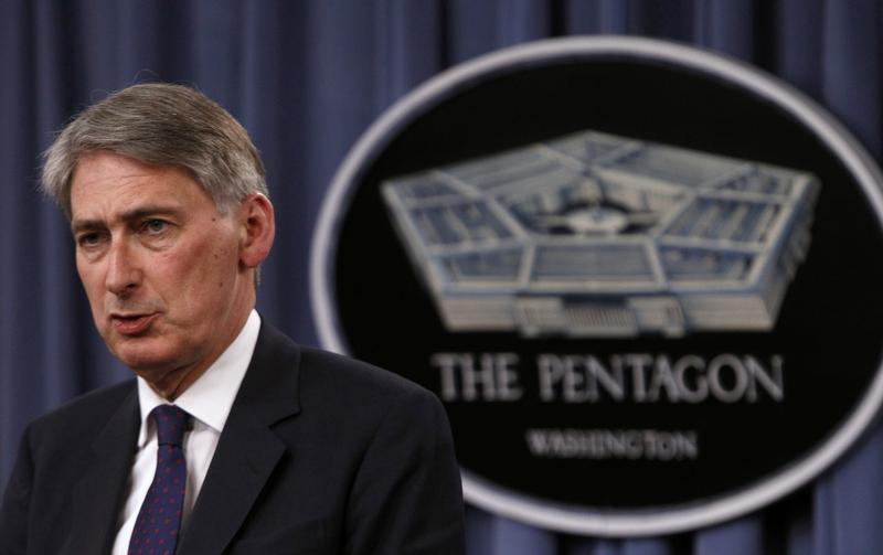 British Defense Secretary Hammond and U.S. Defense Secretary Hagel hold a joint news conference at the Pentagon in Washington