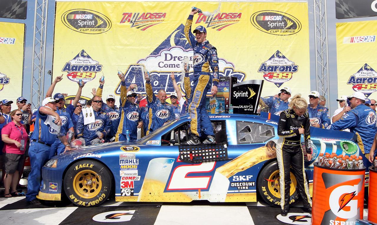TALLADEGA, AL - MAY 06:  Brad Keselowski, driver of the #2 Miller Lite Dodge, celebrates in Victory Lane after winning the NASCAR Sprint Cup Series Aaron's 499 at Talladega Superspeedway on May 6, 2012 in Talladega, Alabama.  (Photo by Jerry Markland/Getty Images for NASCAR)