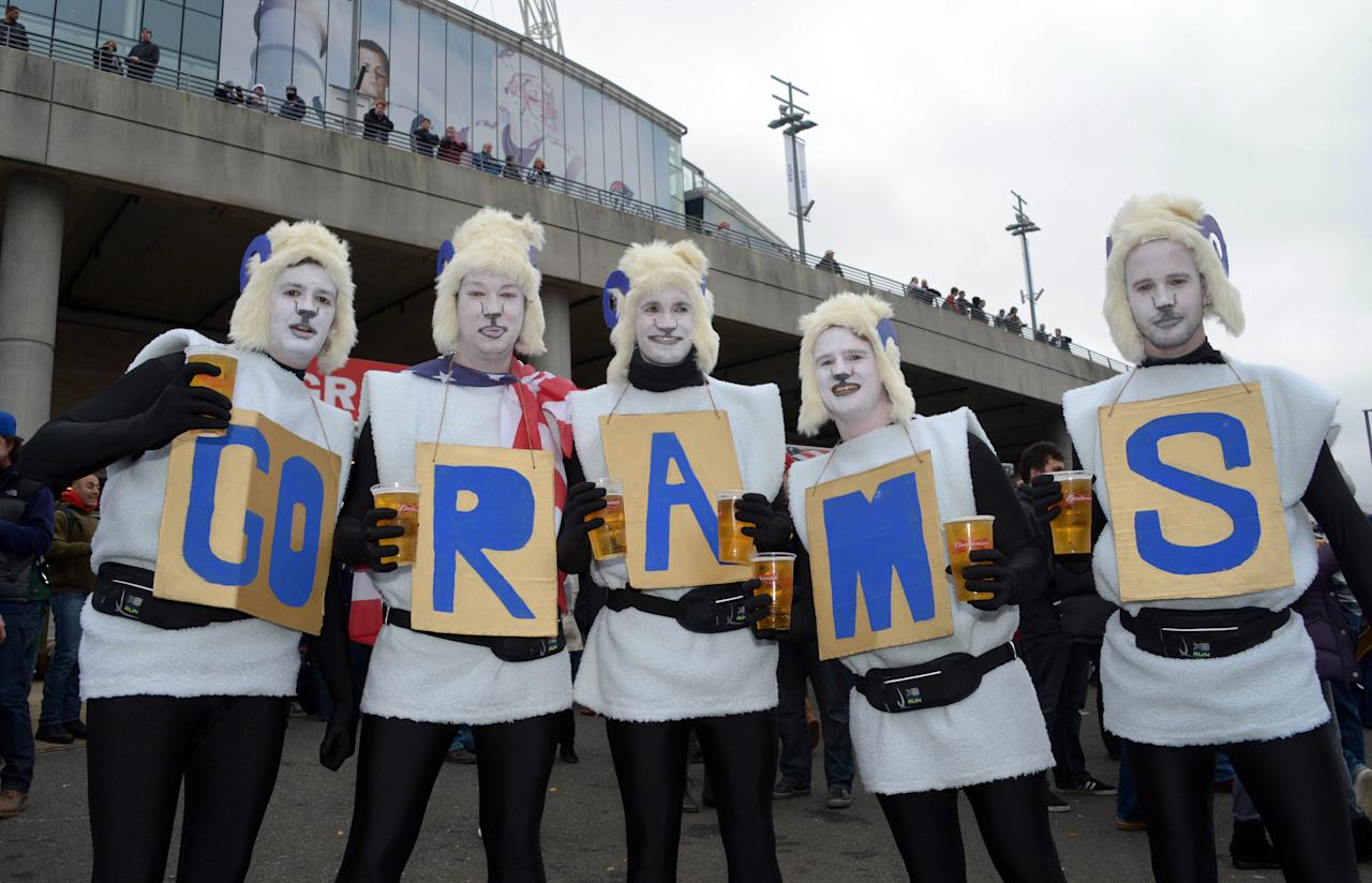 """Oct 28,2012; London, UNITED KINGDOM; St. Louis Rams fans in costumes and face paint spell out """"go rams"""" during tailgate festivities before the 2012 NFL International Series game against the New England Patriots at Wembley Stadium. From left: Ben Caubrook (GO) , Dean Terry (R) , Jack Watson (A) , Glenn Barton (M) and Tom Overton (3). Mandatory Credit: Kirby Lee/Image of Sport-US PRESSWIRE"""