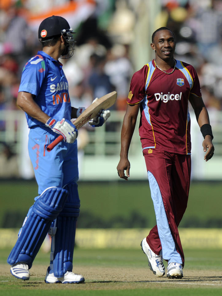 Dwayne Bravo captain of West Indies exchanges a word with Virat Kholi of India during the second Star Sports One Day International (ODI) match between India and The West Indies held at the Dr. Y.S. Rajasekhara Reddy ACA-VDCA Cricket Stadium, Vishakhapatnam, India on the 24th November 2013  Photo by: Pal Pillai - BCCI - SPORTZPICS   Use of this image is subject to the terms and conditions as outlined by the BCCI. These terms can be found by following this link:  http://sportzpics.photoshelter.com/gallery/BCCI-Image-Terms/G0000ahUVIIEBQ84/C0000whs75.ajndY