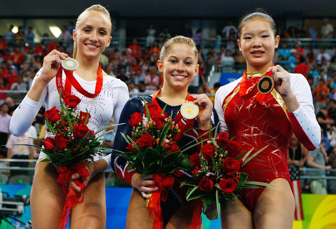 (L-R) Silver medalist Nastia Liukin of the USA, gold medalist Shawn Johnson of the USA and bronze medalist Cheng Fei of China pose on the podium during the medal ceremony for the Women's Beam Final at the National Indoor Stadium on Day 11 of the Beijing 2008 Olympic Games on August 19, 2008 in Beijing, China.