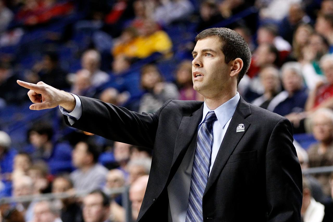LEXINGTON, KY - MARCH 21:  Head Coach Brad Stevens of the Butler Bulldogs reacts to play against the Bucknell Bison in the first half during the second round of the 2013 NCAA Men's Basketball Tournament at the Rupp Arena on March 21, 2013 in Lexington, Kentucky.  (Photo by Kevin C. Cox/Getty Images)
