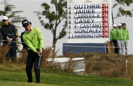 Guthrie plays a shot on the 8th hole during the BMW Masters 2013 golf tournament at Lake Malaren Golf Club in Shanghai
