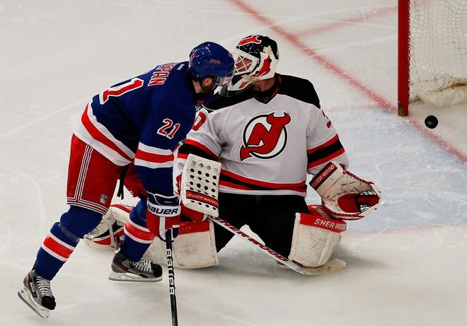 NEW YORK, NY - MAY 14:  Derek Stepan #21 watches as a third period goal by teammate Dan Girardi #5 of the New York Rangers gets past Martin Brodeur #30 of the New Jersey Devils in Game One of the Eastern Conference Finals during the 2012 NHL Stanley Cup Playoffs at Madison Square Garden on May 14, 2012 in New York City.  (Photo by Paul Bereswill/Getty Images)