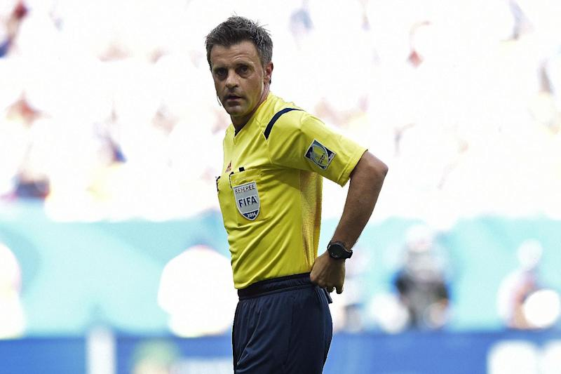 Italian referee Nicolas Rizzoli during a quarter-final football match between Argentina and Belgium at the Mane Garrincha National Stadium in Brasilia during the 2014 FIFA World Cup on July 5, 2014