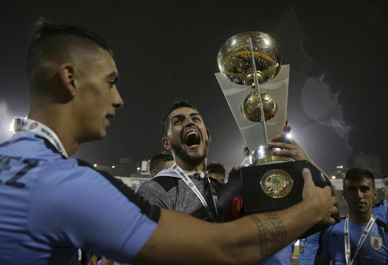 In this Feb. 11, 2017 photo, Uruguay's goalkeeper Santiago Mele, center, celebrates his team's victory at the U-20 South America qualifying soccer tournament in Quito, Ecuador. Uruguay, Brazil, Ecuador and Venezuela qualified for the 2017 South Korea U-20 World Cup. (AP Photo/Dolores Ochoa)