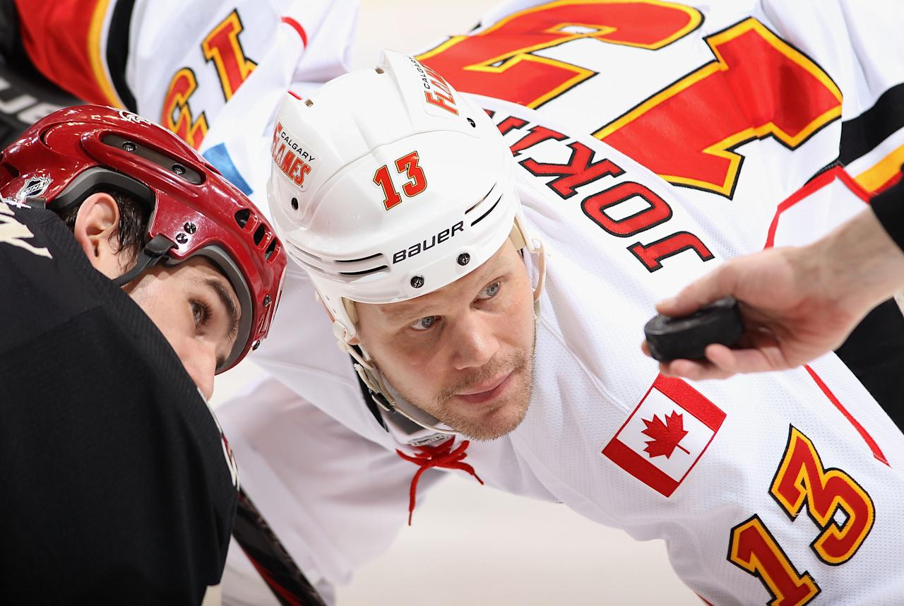 GLENDALE, AZ - MARCH 01:  Olli Jokinen #13 of the Calgary Flames faces off against Boyd Gordon #15 of the Phoenix Coyotes during the NHL game at Jobing.com Arena on March 1, 2012 in Glendale, Arizona.  The Flames defeated the Coyotes 4-2.  (Photo by Christian Petersen/Getty Images)
