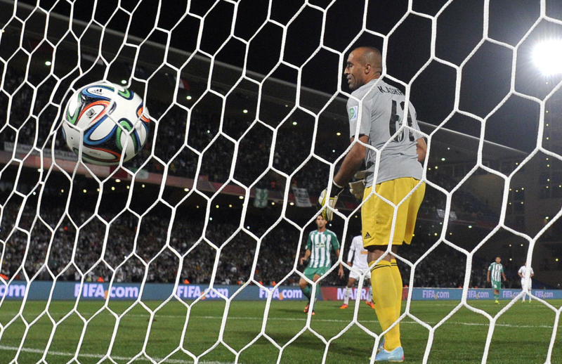 The ball is seen in the net after a goal against Morocco's Raja Casablanca during their semi-final football match as part of the 2013 FIFA Club World Cup, in Marrakesh on December 18, 2013