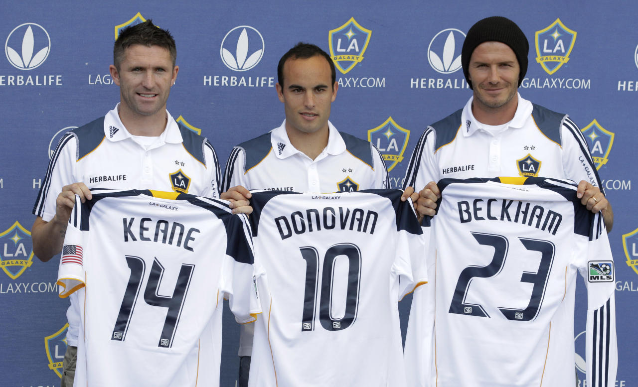 Los Angeles Galaxy players, from left, Robbie Keane, of Ireland, Landon Donovan and David Beckham pose with their jerseys during an MLS news conference at Home Depot Center in Carson, Calif., on Friday, Aug. 19, 2011. (AP Photo/Jae C. Hong)