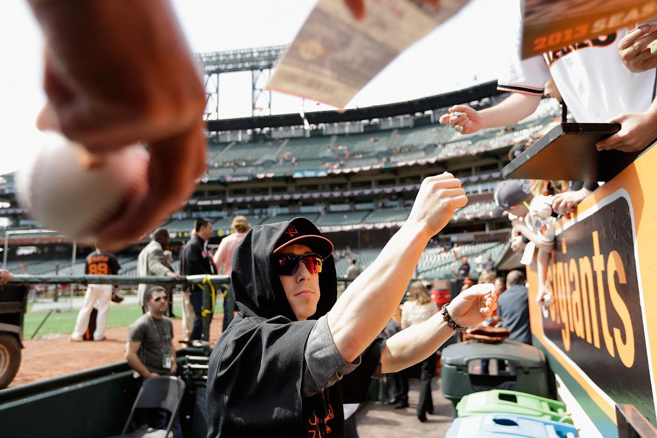 SAN FRANCISCO, CA - APRIL 05: Tim Lincecum #55 of the San Francisco Giants signs autographs before their home game against the St. Louis Cardinals at AT&T Park on April 5, 2013 in San Francisco, California.  (Photo by Ezra Shaw/Getty Images)