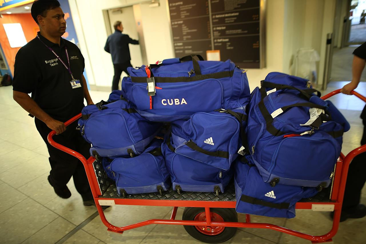 Baggage belonging to the Cuban Olympic weightlifting team is transported through Heathrow Airport on July 16, 2012 in London, England. Athletes, coaches and Olympic officials are beginning to arrive in London ahead of the Olympics.  (Photo by Peter Macdiarmid/Getty Images)