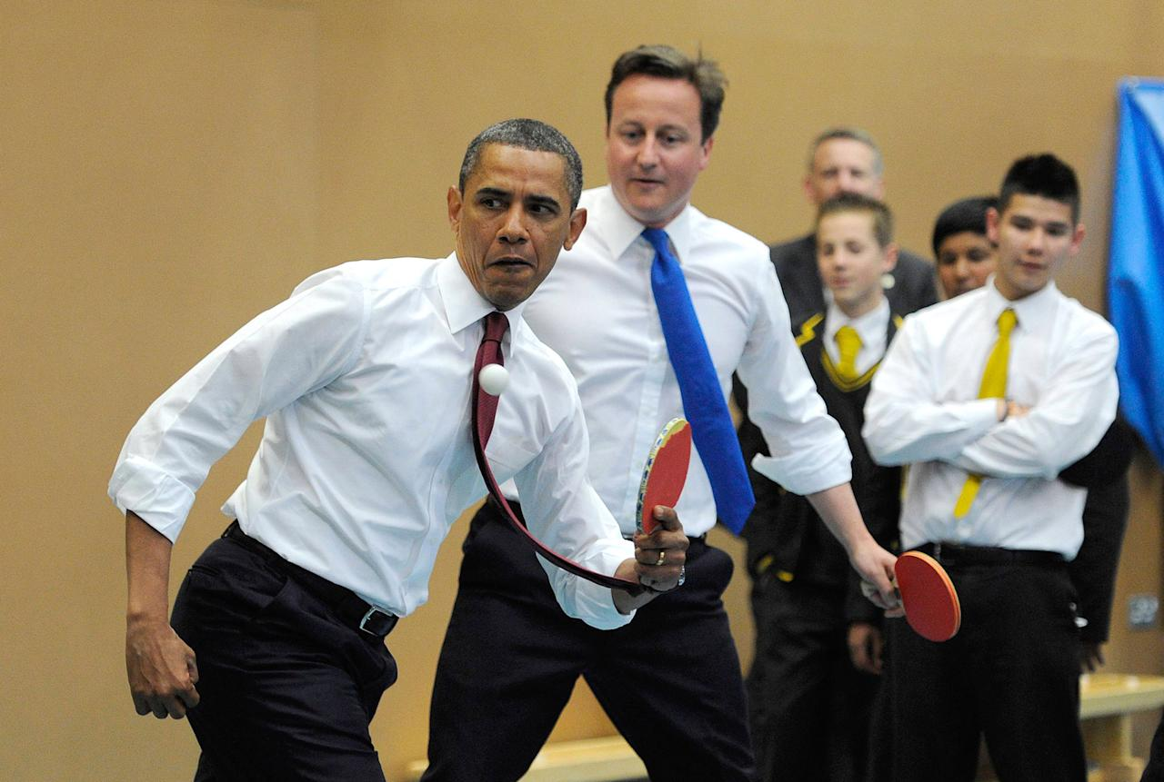 <p>President Barack Obama (L) and Britain's Prime Minister David Cameron play table tennis at Globe Academy on May 24, 2011 in London, England. The 44th President of the United States, Barack Obama, and his wife Michelle are in the UK for a two day State Visit at the invitation of HM Queen Elizabeth II. During the trip they will attend a state banquet at Buckingham Palace and the President will address both houses of parliament at Westminster Hall. (Paul Hackett – WPA Pool/Getty Images) </p>