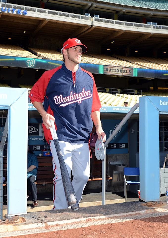 LOS ANGELES, CA - APRIL 28:  Bryce Harper #34 of the Washington Nationals walks on to the field as he makes his major league debut during practice before the game against the Los Angeles Dodgers at Dodger Stadium on April 28, 2012 in Los Angeles, California.  (Photo by Harry How/Getty Images)