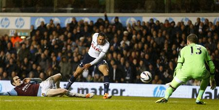 Chadli of Tottenham Hotspur has his shot saved by Adrian of West Ham United during their English League Cup soccer match at White Hart Lane, London