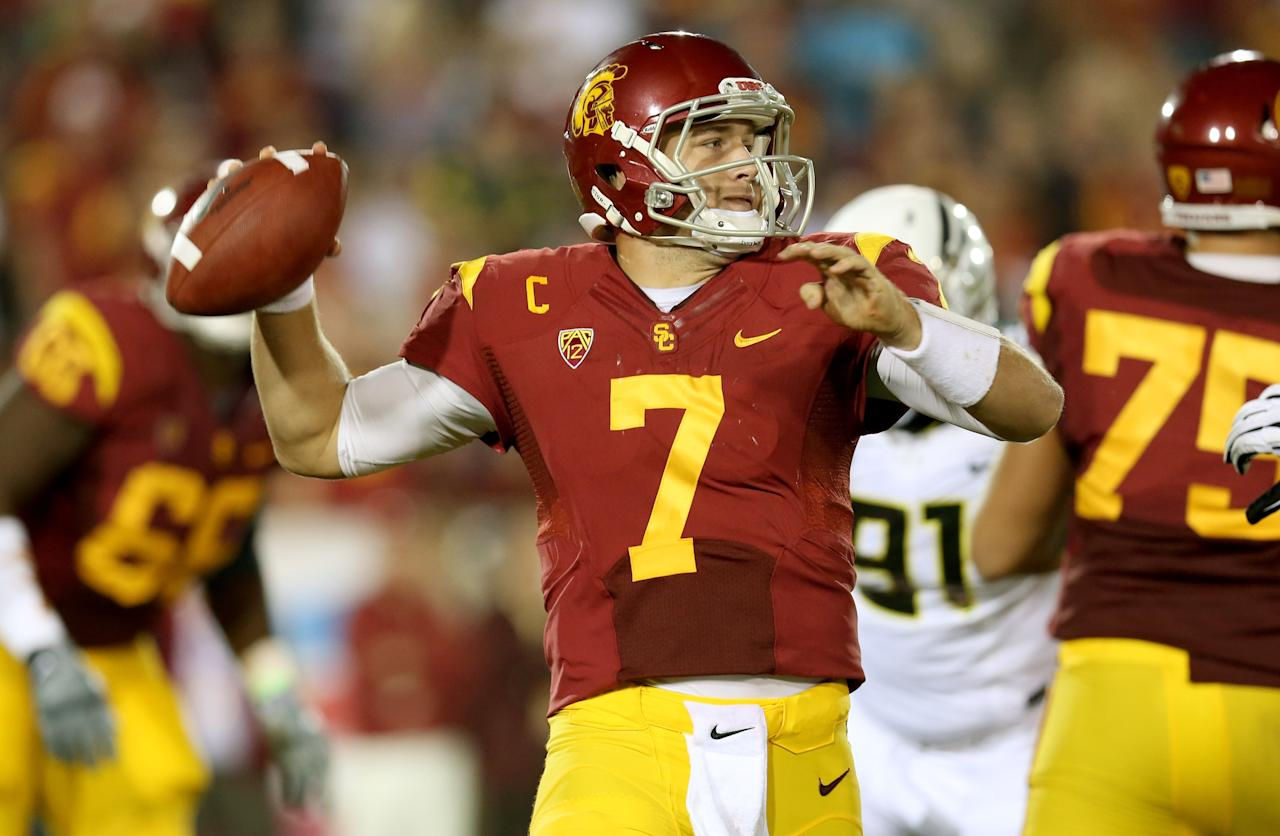 LOS ANGELES, CA - NOVEMBER 03:  Quarterback Matt Barkley #7 of the USC Trojans throws a pass against the Oregon Ducks at the Los Angeles Memorial Coliseum on November 3, 2012  in Los Angeles, California. Oregon won 62-51.  (Photo by Stephen Dunn/Getty Images)