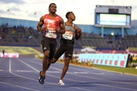 Athletics - Jamaica National Trials - Kingston - 03/07/16 Winner Yohan Blake (L) and Julian Forte (R) in action during men's 200m final race. REUTERS/Gilbert Bellamy