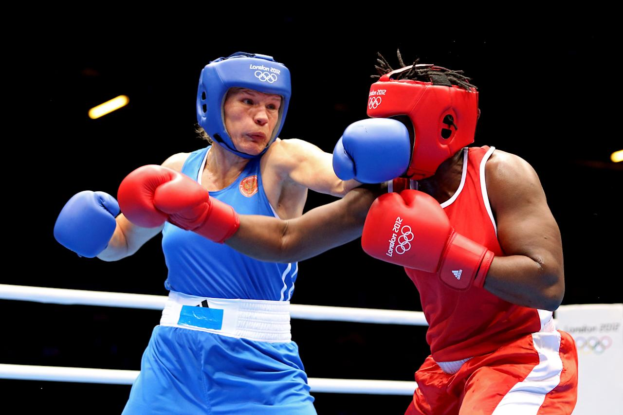 LONDON, ENGLAND - AUGUST 06:  Nadezda Torlopova (Blue) of Russia competes against Edith Ogoke (Red) of Nigeria during the Women's Middle (75kg) Boxing Quarterfinals on Day 10 of the London 2012 Olympic Games at ExCeL on August 6, 2012 in London, England.  (Photo by Scott Heavey/Getty Images)
