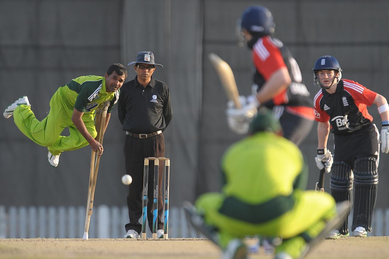 Pakistan disabled cricketer Farhan Saeed (L) delivers the ball during the T20 match between England Disaballity team and Pakistan Disaballity team at the ICC Global Cricket Academy (ICC GCA) in Dubai Sports City on February 11, 2012. Cricketers with disabilities from Pakistan and England promise to defy all odds during their ground-breaking series which starts on Saturday, hoping it could set examples for such other people in life. AFP PHOTO/ LAKRUWAN WANNIARACHCHI (Photo credit should read LAKRUWAN WANNIARACHCHI/AFP/Getty Images)