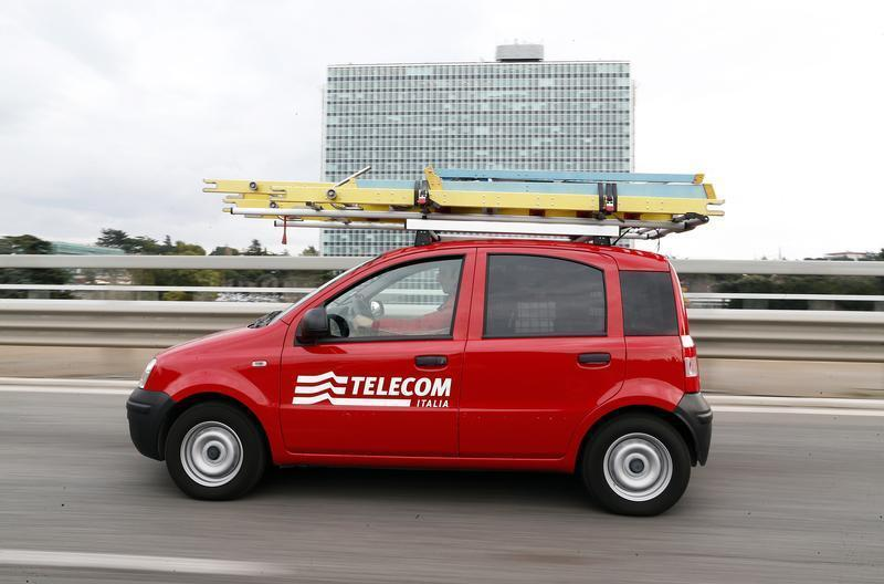 Telecom Italia technical office personnel drives a car in Rome