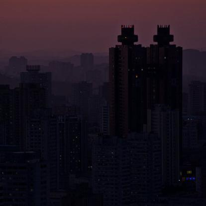 The Koryo hotel in Pyongyang after sunset. Since North Korea has had power issues since the 90's, much of the city remains dark at night with many apartments only lit with a single fluorescent bulb. However, many of the cities most important landmarks are lit with floodlights.