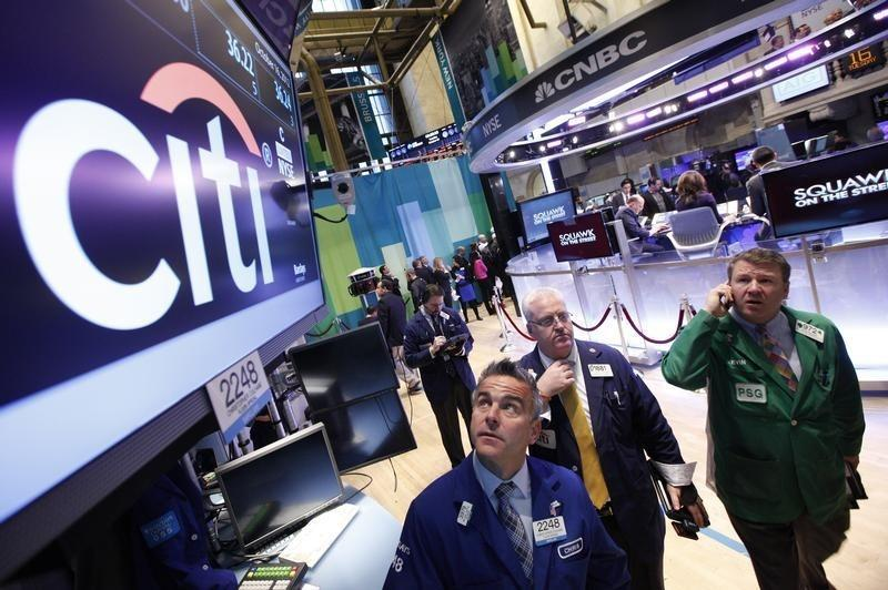 Traders work at the trading post that trades Citigroup stock on the floor of the New York Stock Exchange