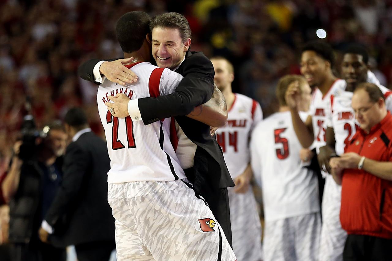 (L-R) Chane Behanan #21 and head coach Rick Pitino of the Louisville Cardinals celebrate after they won 82-76 against the Michigan Wolverines during the 2013 NCAA Men's Final Four Championship at the Georgia Dome on April 8, 2013 in Atlanta, Georgia.  (Photo by Andy Lyons/Getty Images)