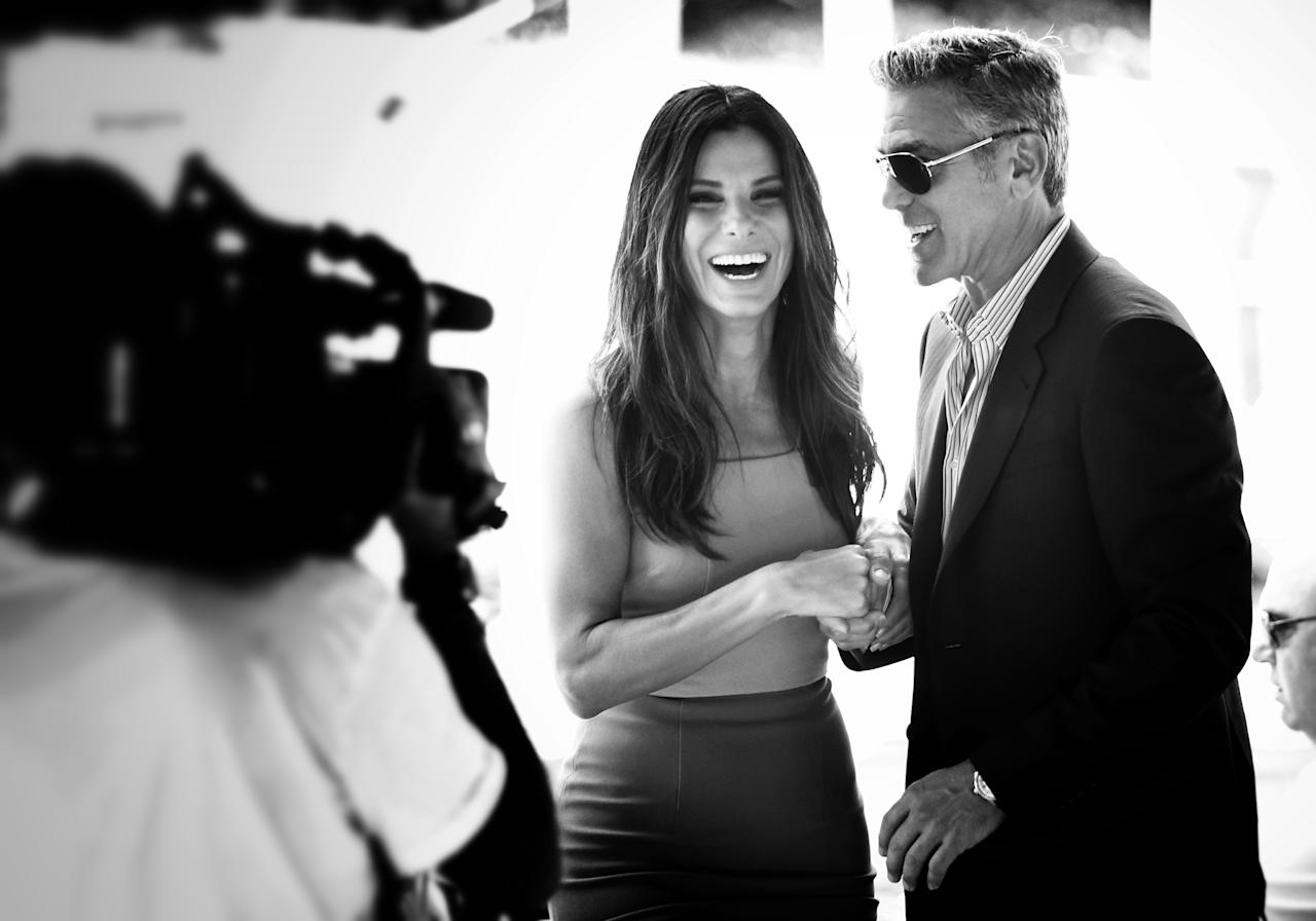 VENICE, ITALY - AUGUST 28: (EDITORS NOTE: Image has been converted to black and white) An alternative view of actors Sandra Bullock and George Clooney who attend the 'Gravity' photocallthe 70th Venice International Film Festival on August 28, 2013 in Venice, Italy. (Photo by Andreas Rentz/Getty Images)