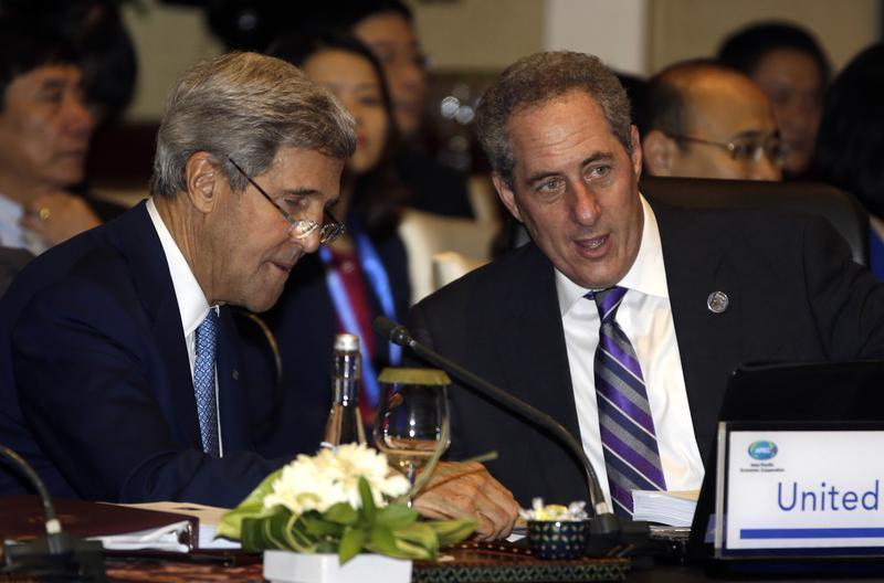 U.S. Secretary of State John Kerry and U.S. Trade Representative Michael Froman talk prior to the Asia Pacific Economic Cooperation ministerial meeting in Bali