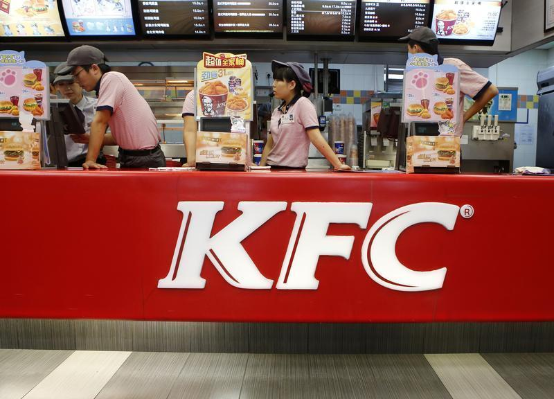 KFC's staff wait for customers at its restaurant in Beijing