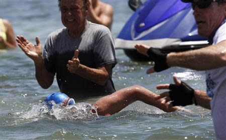 U.S. long-distance swimmer Diana Nyad, 64, completes her swim from Cuba as she arrives in Key West, Florida, September 2, 2013. REUTERS/Andrew Innerarity