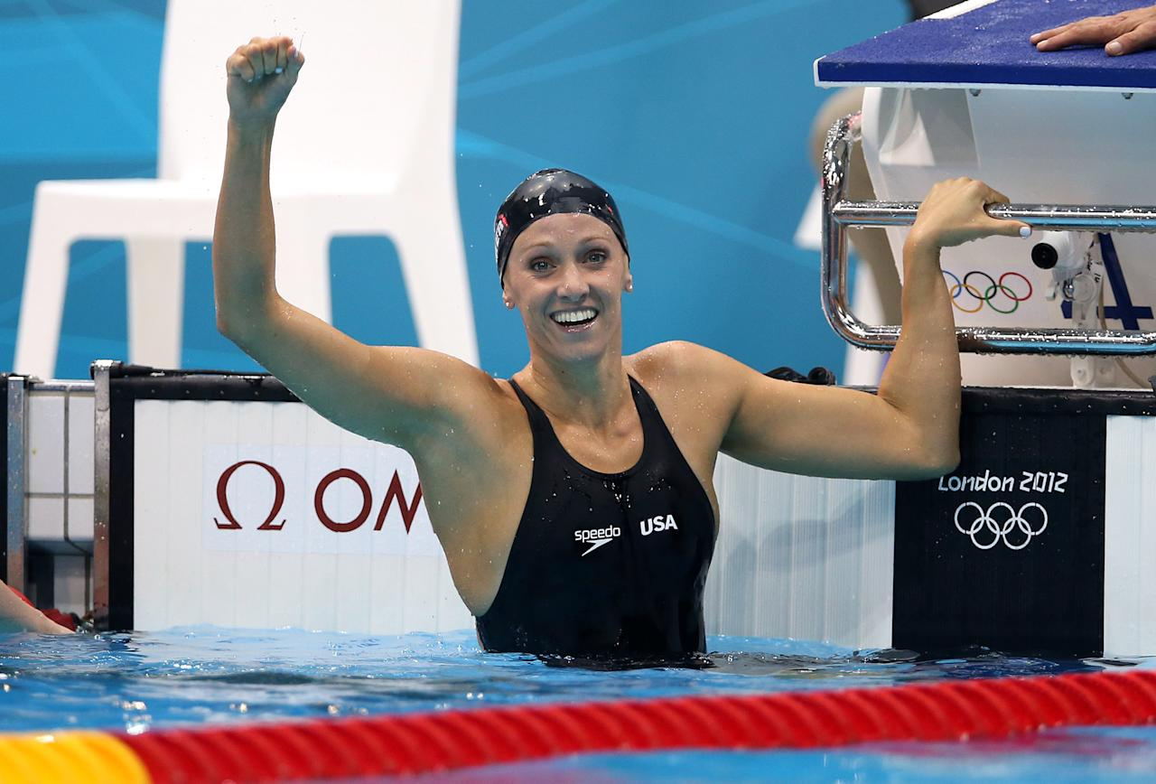 LONDON, ENGLAND - JULY 29:  Dana Vollmer of the United States celebrates after winning the gold medal and setting a new world record in the Womans 100m Butterfly during the 2012 London Olympics at the Aquatics Centre  on July 29, 2012 in London, England.  (Photo by Ian MacNicol/Getty Images)