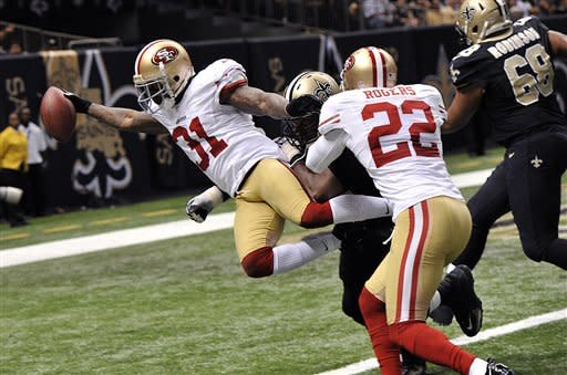 49ers use Kaepernick, defense to top Saints 31-21