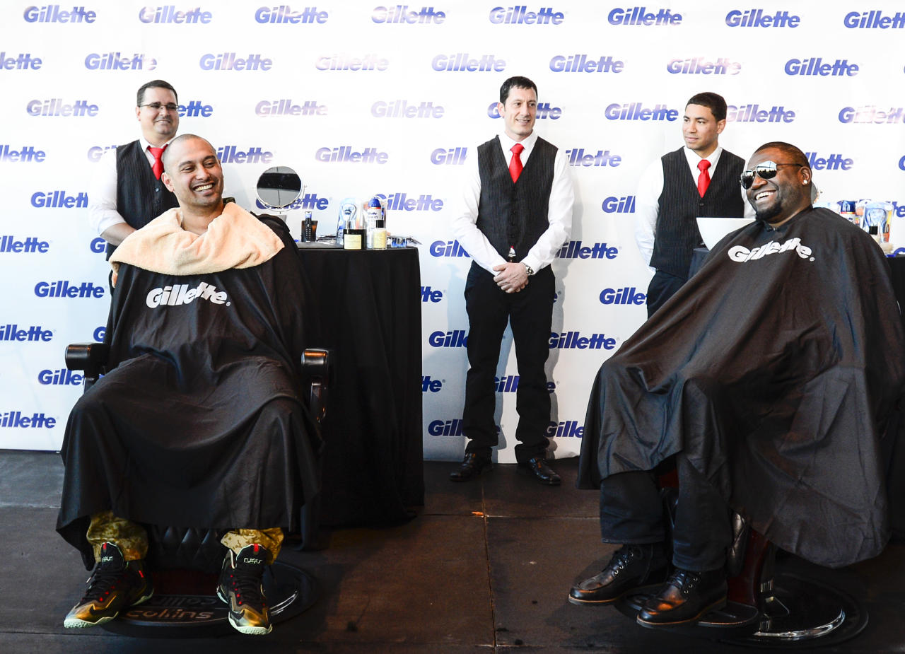 IMAGE DISTRIBUTED FOR GILLETTE - World Series victors David Ortiz, right, and Shane Victorino, left, of the Boston Red Sox get a smooth start to the offseason after a shave from Art of Shaving master barbers at Gillette World Shave Headquarters, on Monday, Nov. 4, 2013 in Boston. (Photo by John Cetrino/Invision for Gillette/AP Images)