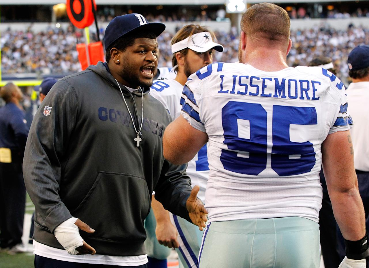 ARLINGTON, TX - DECEMBER 16:  Dallas Cowboys player, Josh Brent talks with teammate Sean Lissemore #95 as the Cowboys take on the Pittsburgh Steelers at Cowboys Stadium on December 16, 2012 in Arlington, Texas. Brent is facing intoxication manslaughter charges after a one-car automobile accident that resulted in the death of teammate Jerry Brown. (Photo by Tom Pennington/Getty Images)