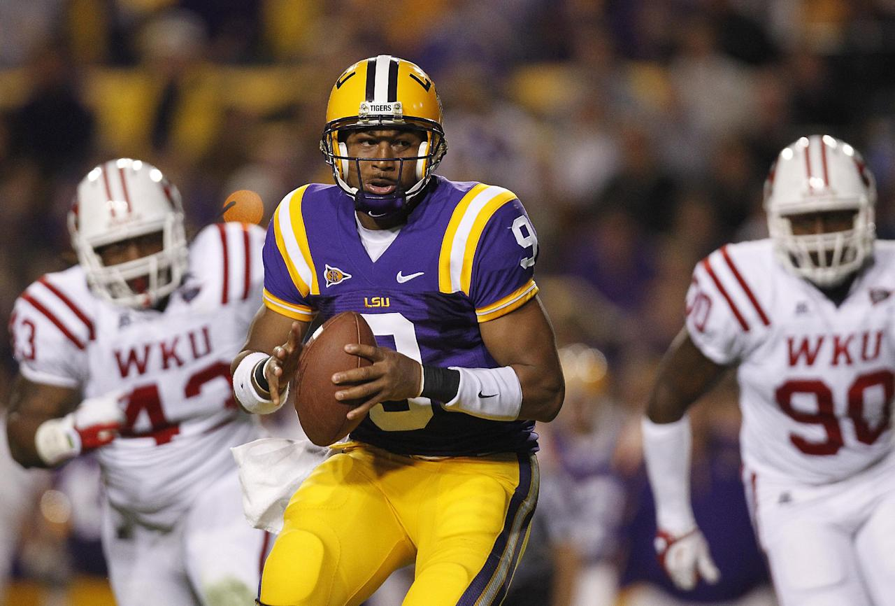 LSU quarterback Jordan Jefferson (9) looks for a receiver as Western Kentucky defensive lineman Jamarcus Allen (43) and defensive lineman Bo Adebayo (90) pursue during the second quarter of their NCAA college football game in Baton Rouge, La., on Saturday, Nov. 12, 2011. (AP Photo/Gerald Herbert)