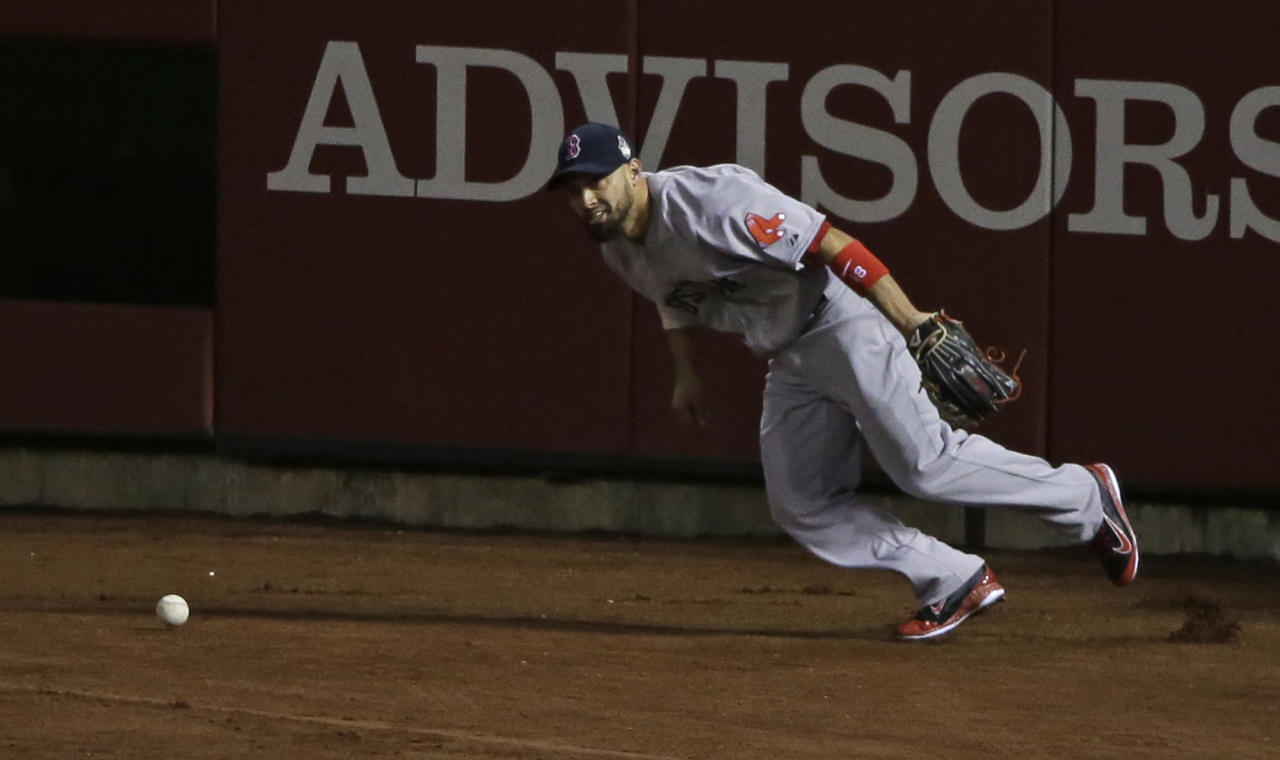 Boston Red Sox's Shane Victorino has trouble with a double hit by St. Louis Cardinals' Matt Adams during the fifth inning of Game 3 of baseball's World Series Saturday, Oct. 26, 2013, in St. Louis. (AP Photo/Charlie Neibergall)