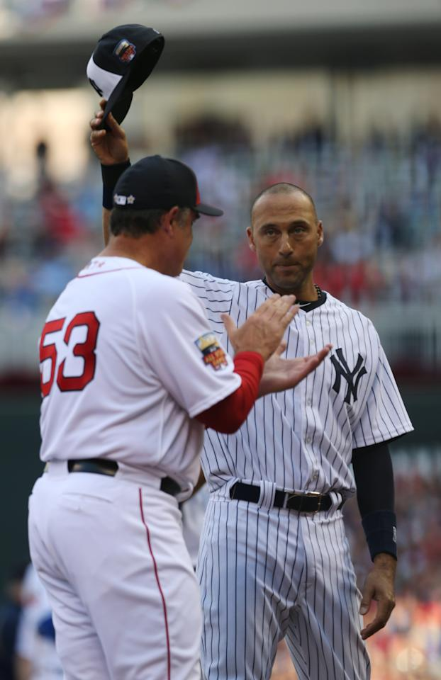 American League shortstop Derek Jeter, of the New York Yankees, waves to the crowd as American League Manager John Farrell, of the Boston Red Sox, left, looks on before the MLB All-Star baseball game, Tuesday, July 15, 2014, in Minneapolis. (AP Photo/Jim Mone)