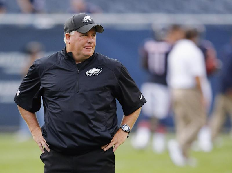 Philadelphia Eagles coach Chip Kelly watches his players warm up for an NFL preseason football game against the Chicago Bears on Friday, Aug. 8, 2014, in Chicago