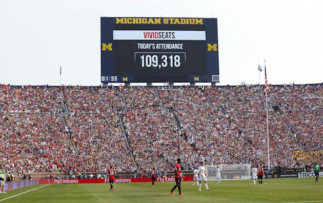 The scoreboard announces attendance of 109,318 during a friendly between Real Madrid and Manchester United. (AP Photo)