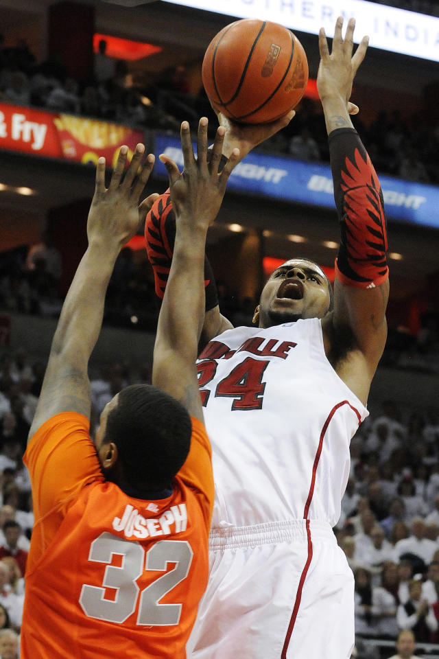 Louisville's Chane Behanan, right, shoots over Syracuse's Kris Joseph (32) during the second half of their NCAA college basketball game, Monday, Feb. 13, 2012, in Louisville, Ky. Syracuse won 52-51. (AP Photo/Timothy D. Easley)