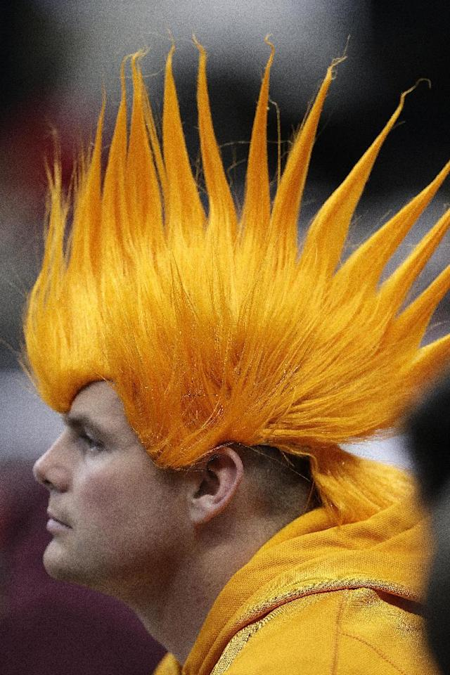 A Tennessee fan watches play against Massachusetts during the second half of an NCAA college basketball second-round tournament game, Friday, March 21, 2014, in Raleigh, N.C. (AP Photo/Gerry Broome)