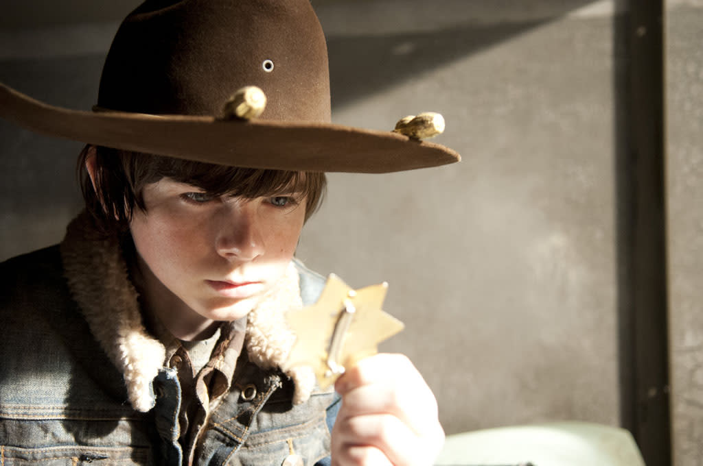 "Carl Grimes (Chandler Riggs) in ""The Walking Dead"" Season 3 Finale, ""Welcome to the Tombs."""