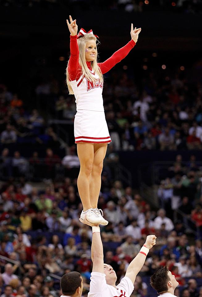 The North Carolina State Wolfpack cheerleaders perform on the court against the Georgetown Hoyas during the third round of the 2012 NCAA Men's basketball tournament at Nationwide Arena on March 18, 2012 in Columbus, Ohio.  (Photo by Rob Carr/Getty Images)