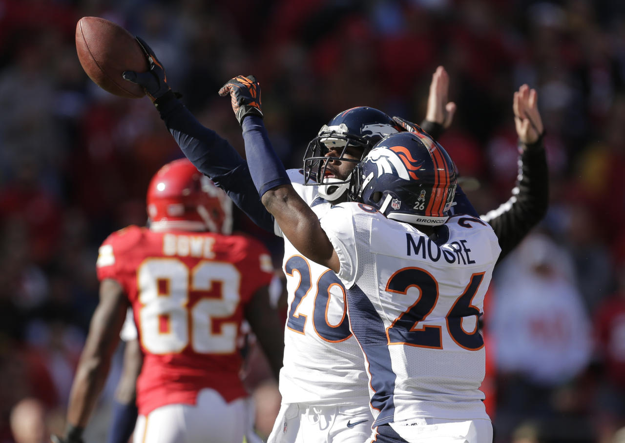 Denver Broncos strong safety Mike Adams (20) celebrates a fumble recovery with free safety Rahim Moore (26) during the first half of an NFL football game against the Kansas City Chiefs at Arrowhead Stadium in Kansas City, Mo., Sunday, Nov. 25, 2012. (AP Photo/Charlie Riedel)