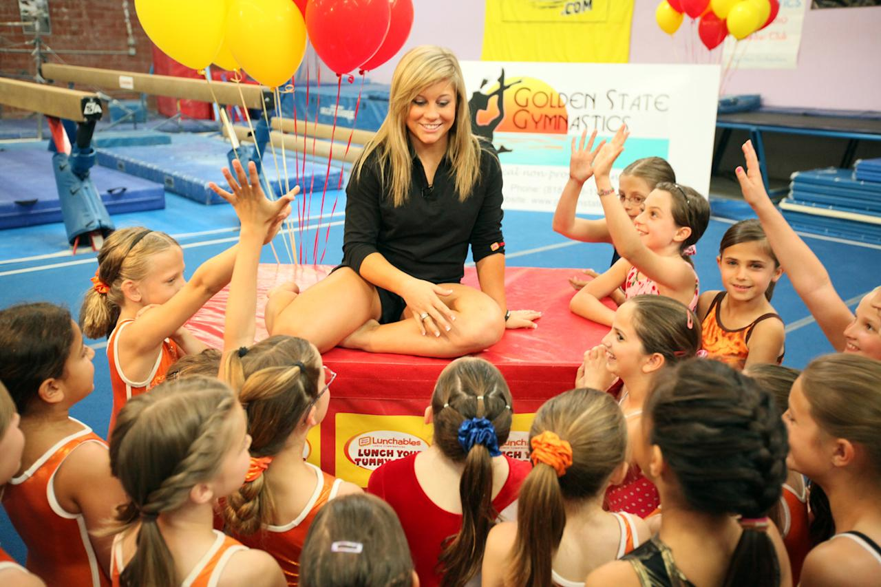 Shawn Johnson makes a surprise visit and offers coaching tips to aspiring gymnasts at the Golden State Gym in Burbank, CA on May 13, 2009. Shawn was kicking off The Lunchables Lunch Your Tummy Right Tour, a cross-country tour aiming to inspire kids to achieve success.